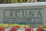 sign in front of Lacuna Golf and Country Club in Lake Worth