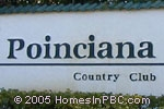 sign in front of Poinciana Place in Lake Worth