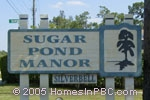 sign in front of Sugar Pond Manor in Wellington