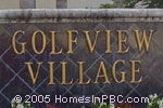 sign in front of Village on the Green / Golfview Village in Lake Worth