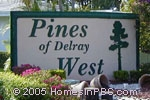 sign in front of The Pines of Delray West in Delray Beach
